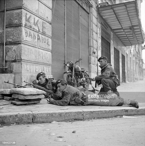 The British Army In Greece 1944, Paratroops from 5th Parachute Battalion, 2nd Parachute Brigade, take cover on a street corner in Athens during...