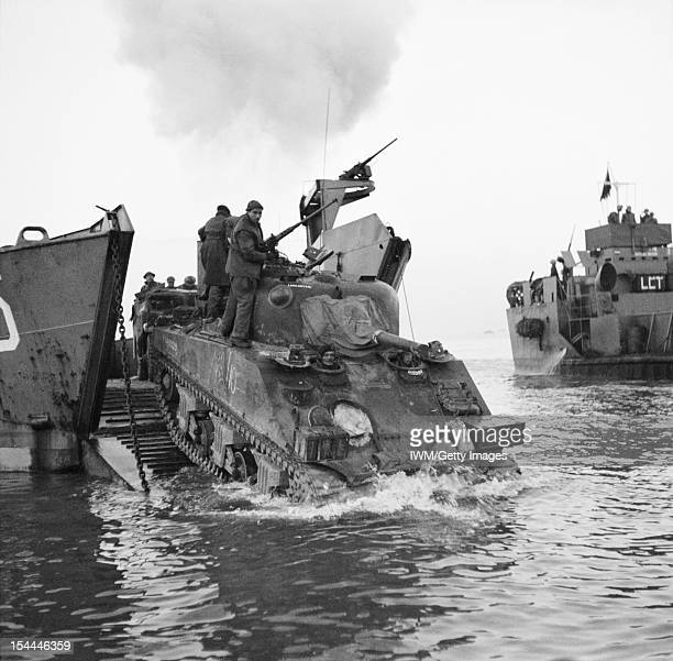 The British Army In Italy 1944 A Sherman tank of 23rd Armoured Brigade coming ashore from a landing craft at Anzio 22 January 1944