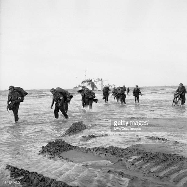 The British Army In Normandy 1944 Followup troops wade ashore from landing craft on Queen sector of Sword Beach 7 June 1944