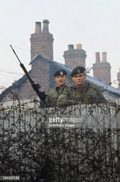The British Army In Northern Ireland 1969 2007 2nd Lieutenant Robin Martin and Rifleman Andy Walker of 1st Royal Green Jackets man a barbed wire...