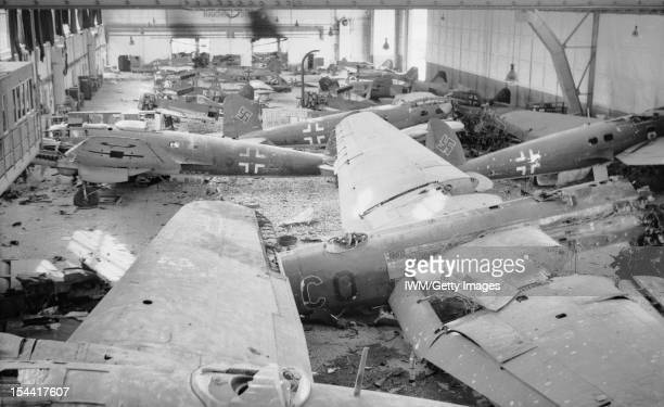 The British Army In NorthWest Europe 194445 A hangar full of wrecked German aircraft at Schmarbeck airfield 20 April 1945 In the foreground are...