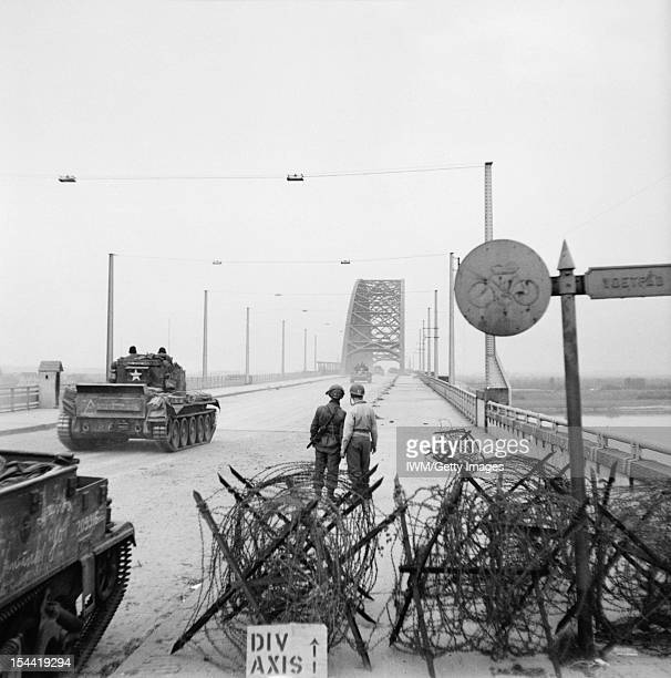 The British Army In North-West Europe 1944-45, Cromwell tanks of 2nd Welsh Guards crossing the bridge at Nijmegen, 21 September 1944.