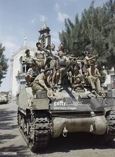 The British Army In Sicily August 1943 At Milo in the north of Sicily County of London Yeomanry tank men are accorded a great reception by the...