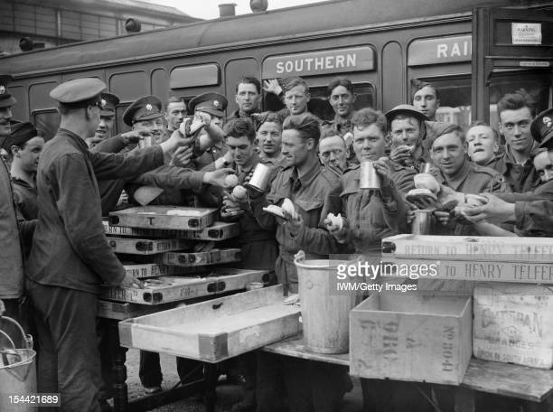 The British Army In The UK: Evacuation From Dunkirk, May - June 1940, Evacuated troops enjoying tea and other refreshments at Addison Road station,...