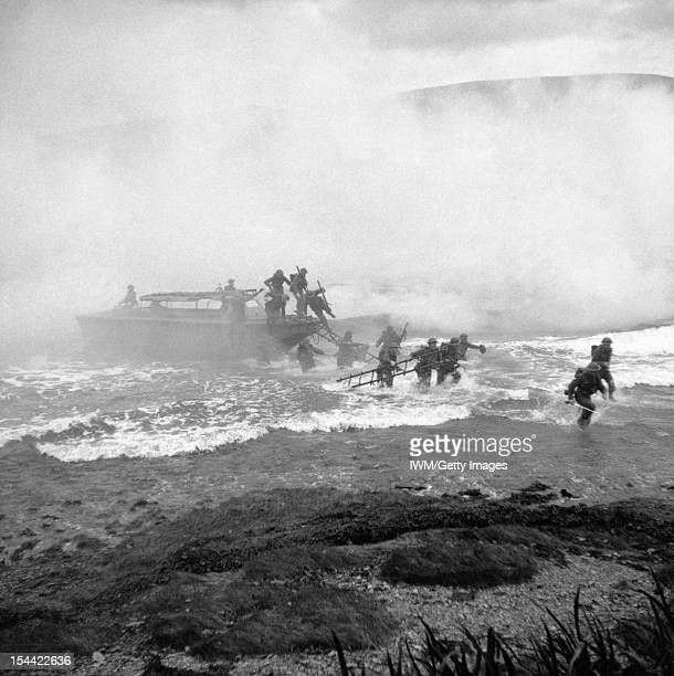 The British Army In The United Kingdom 19391945 Troops coming ashore from a landing craft under a smoke screen during Combined Operations training at...