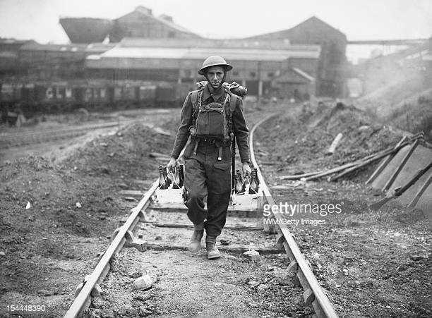 The British Army In The United Kingdom 1939-45, A sapper from 211 Field Park Company, Royal Engineers, attached to 44th Infantry Division, carrying...
