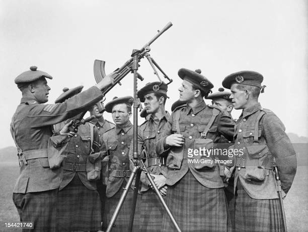 The British Army In The United Kingdom 193945 Men of the 1st Battalion Cameron Highlanders receive instruction on a Bren gun fitted on an...