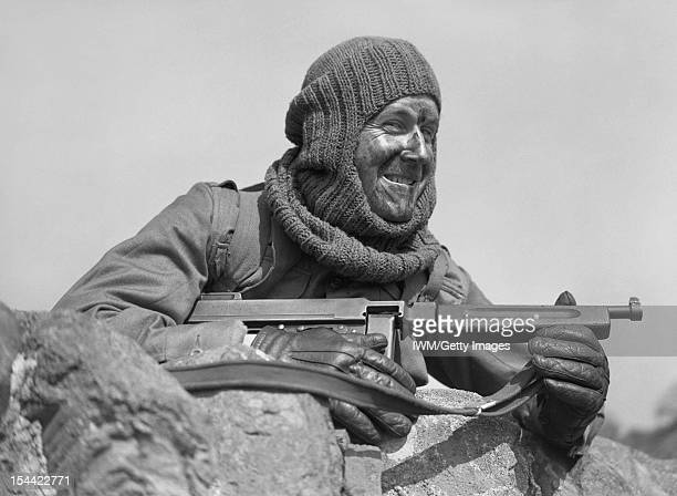 The British Army In The United Kingdom 1939-45, Portrait of a soldier from No. 3 Commando armed with a 'Tommy gun' and wearing a balaclava, at Largs...