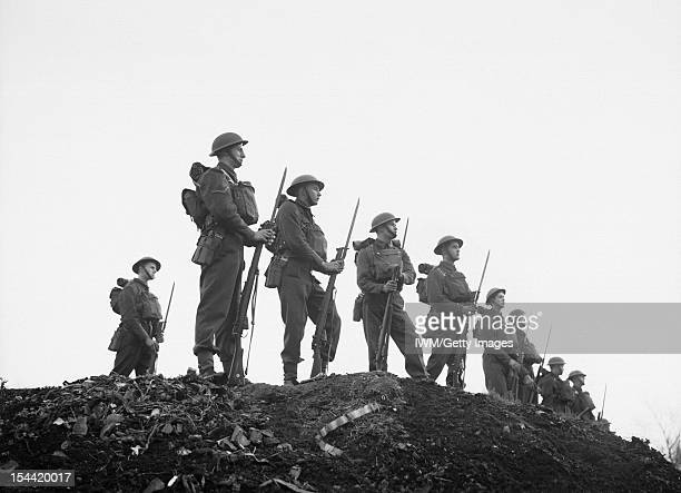 The British Army In The United Kingdom 193945 Soldiers of the East Surrey Regiment pose with fixed bayonets at Chatham in Kent 25 November 1940