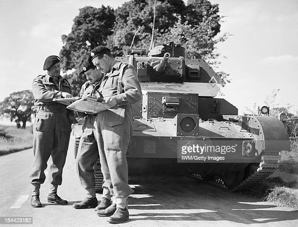 The British Army In The United Kingdom 193945 Tank officers confer in front of a Cruiser Mk IVA during exercises in East Anglia 30 August 1940
