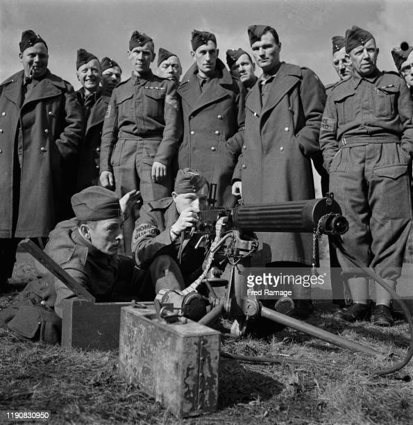 The British Army train members of the Home Guard in the use of machine guns during World War II UK March 1941