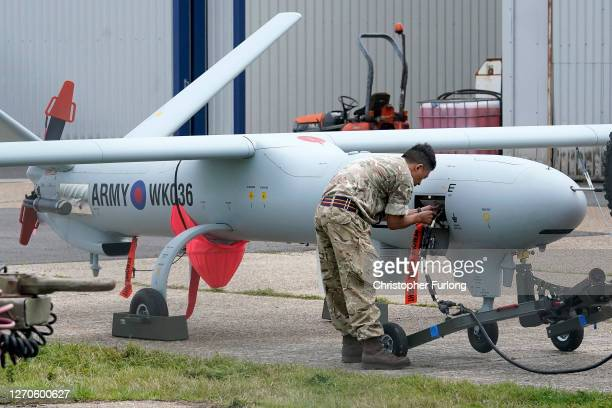 The British army's Watchkeeper drone sits on the apron at Lydd Airport after a surveillance flight over the English Channel on September 04, 2020 in...