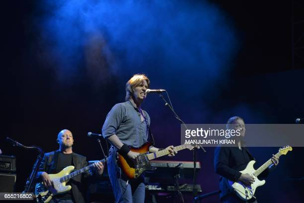 The British band Dire Straits Experience perform during the Play for a Cause concert in Bangalore on March 19 2017 / AFP PHOTO / MANJUNATH KIRAN