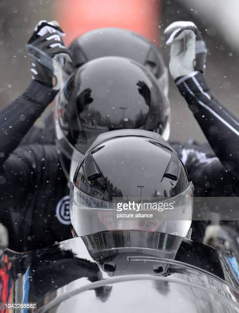 The British bobber John James Jackson Stuart Benson Bruce Tasker and Joel Fearon start for the fourman bob during the Bobsleigh World Cup in...
