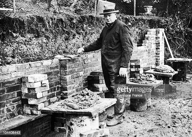The British Chancellor of the Exchequer Winston CHURCHILL restoring his property of Chartwell Manor He was passionated by masonry and was making the...