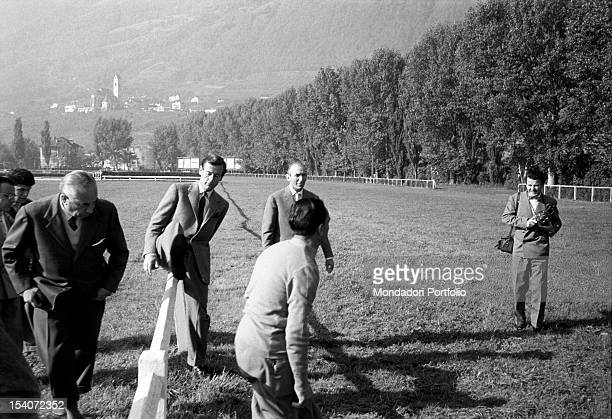 The British colonel and aviator Peter Townsend climbs over the fence of a circuit riding at a horse show. Merano, 1955