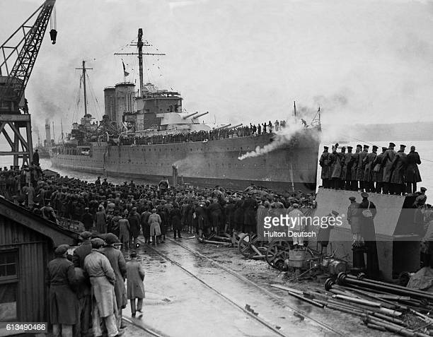 The British cruiser Exeter arrives back at Plymouth after a battle with the German pocketbattleship Admiral Graf Spee in the South Atlantic