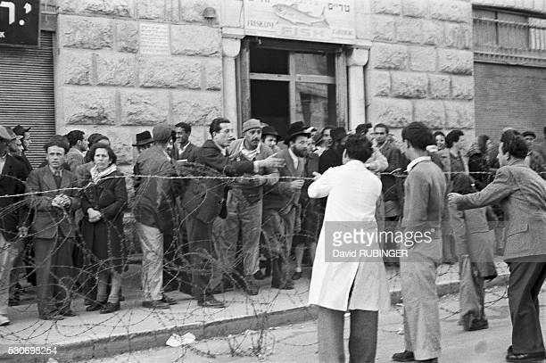 The British declare martial law in parts of Jerusalem following actions by the IZL Areas are fenced in with barbed wire