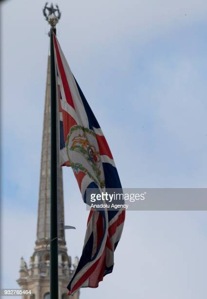 The British embassy's flag waves as the Soviet Union's emblem star is seen in the background in Moscow Russia on March 16 2018 Britain has expelled...