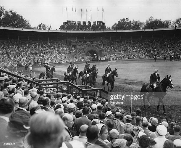 The British Equestrian team parading past the Royal Box during the opening ceremony of the Equestrian Olympic Games in Stockholm Sweden