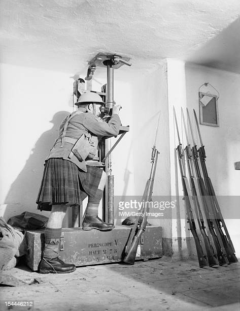 The British Expeditionary Force In France 19391940 51st Highland Division in the Maginot Line A soldier from the Cameron Highlanders looks through a...