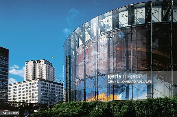 The British Film Institute London Imax Cinema designed by Avery Associates with the Shell Building in the background London England United Kingdom