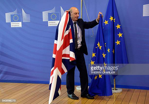 The British flag is being replaced by the European Union flag following the visit of British Prime Minister David Cameron at the European Union...