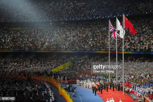 The British flag is raised for the handoff for the 2012 Paralympics during the 2008 Paralympics Closing Ceremony at National Stadium during day...