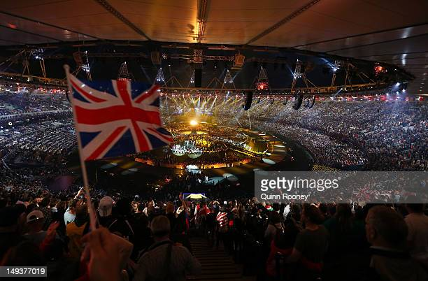 The British flag is waved by a spectator as the Olympic cauldron is lit during the Opening Ceremony of the London 2012 Olympic Games at the Olympic...
