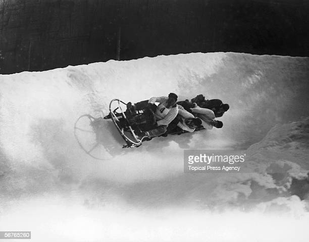 The British four-man bobsleigh team in action at the Winter Olympics at Chamonix, February 1924. The team, Ralph Broome, Thomas Arnold, Alexander...