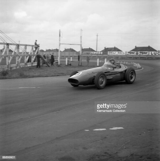 The British Grand Prix Aintree July 20 1957 Juan M anuel Fangio in the corner at the end of the pit straight in his Maserati 250F