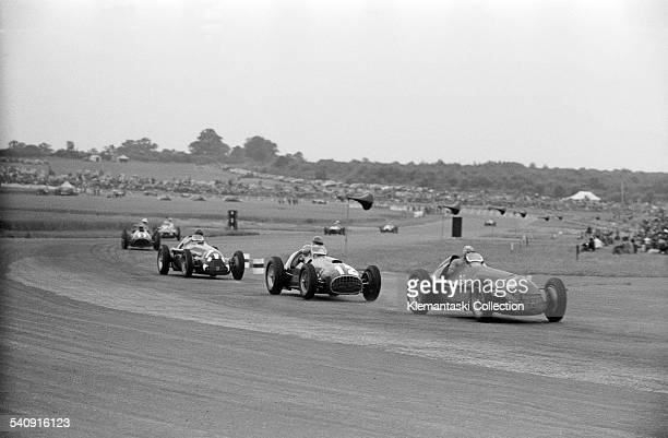 The British Grand Prix Silverstone July 14 1951 Just after the start the field rounds Abbey Curve Felice Bonetto is leading with his Alfa Romeo Tipo...