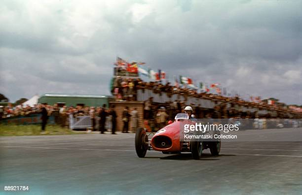 The British Grand Prix Silverstone July 18 1953 Giuseppe Farina passes the pits with his Ferrari 500/F2 He would finish third