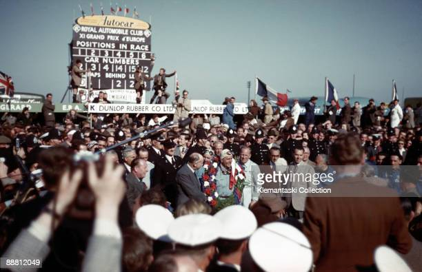 The British Grand Prix; Silverstone, May 13, 1950. A congratulatory crowd surrounds Giuseppe Farina, the winner, on his way to the first postwar...