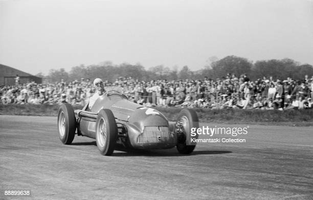 The British Grand Prix; Silverstone, May 13, 1950. At Stowe Corner, the eventual winner, Giuseppe Farina, sets up his Alfa 158 for the bend.