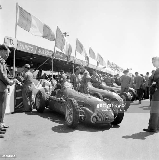 The British Grand Prix; Silverstone, May 13, 1950. The Alfa Romeo team cars lined up in front of the temporary pits, which were then located between...