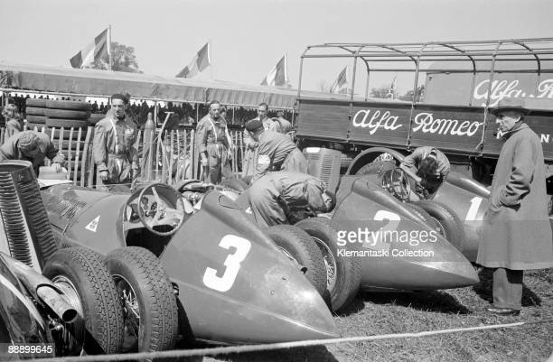 The British Grand Prix; Silverstone, May 13, 1950. The Alfa team cars in the paddock before the start. These are the cars of Luigi Fagioli,'Nino'...