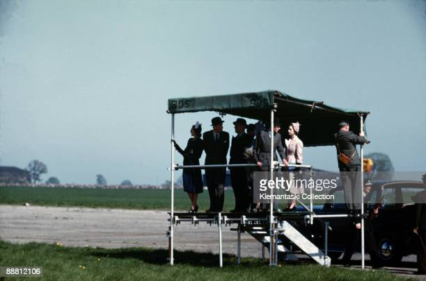 The British Grand Prix; Silverstone, May 13, 1950. The British Royal Family watching the race from their special stand with Princess Margaret in the...