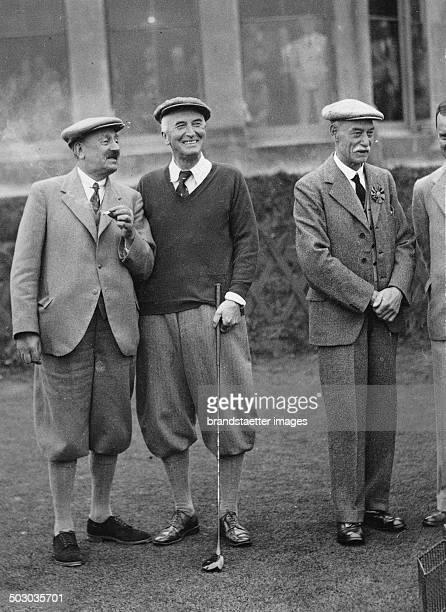 The British Home Secretary John Allsebrook Simon playing golf in St. Andrews. 1st October 1936. Photograph.