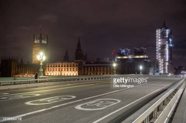 The British Houses of Parliament seen with their lights back on after celebrating Earth Hour 2020 on March 28 2020 in London England The initiative...