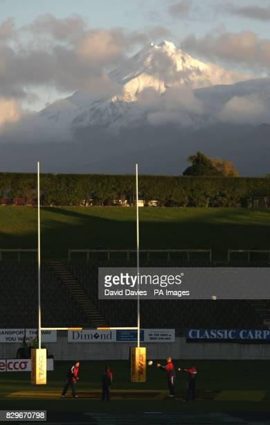 The British Irish Lions look around Yarrow Stadium under the shadow of Mount Egmont