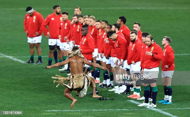 The British & Irish Lions team are challenged by a Zulu warrior prior to the 2nd test match between South Africa Springboks and the British & Irish...