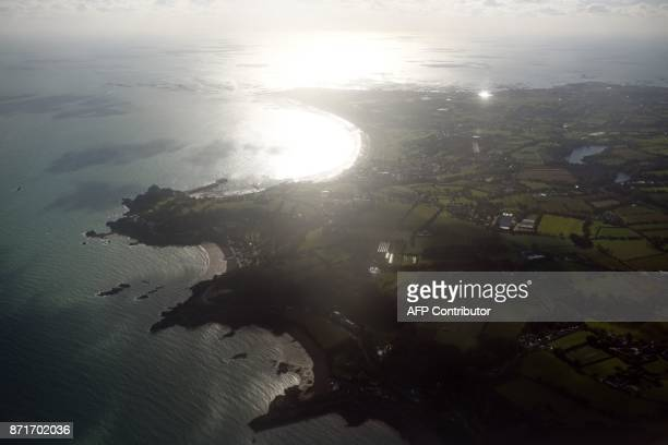 The British island of Jersey is pictured from the window of an aircraft on November 8 2017 Jersey is a British Crown Dependency with a population of...