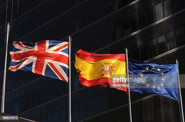 The British left Spanish center and European Union flags fly outside the Cuatro Torres office buildings in Madrid Spain on Monday May 3 2010 Stocks...