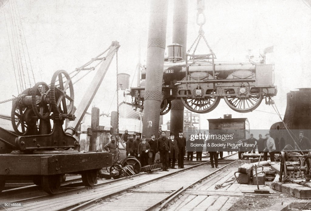 Loading a steam locomotive onto a ship, Newhaven, East Sussex, late 1800s. : News Photo