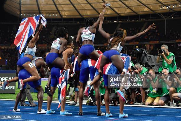 The British men's and women's 4x100m relay teams pose for photographers after the men's 4x100m relay final during the European Athletics...
