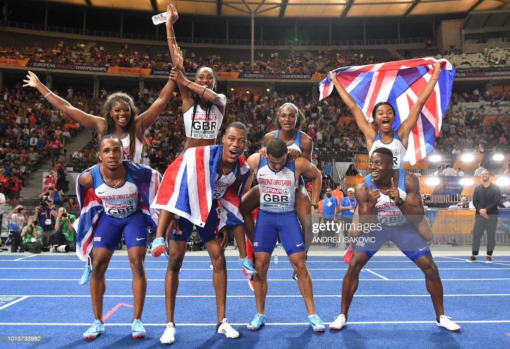 The British men's and women's team pose after the men's 4x100m relay final during the European Athletics Championships at the Olympic stadium in Berlin on August 12, 2018.