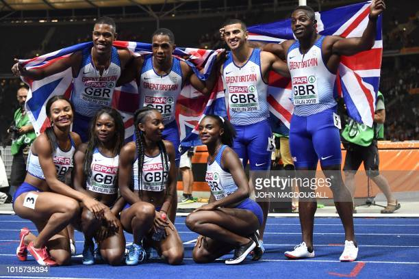 The British men's and women's team pose after the men's 4x100m relay final during the European Athletics Championships at the Olympic stadium in...