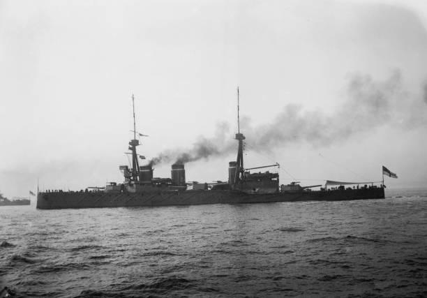 The British Navy battlecruiser HMS Invincible, taking...