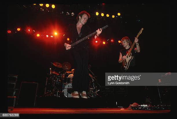1982 The British pop band The Police live in concert In the foreground bassist and singer Sting jumps up from the stage while playing and Andy...